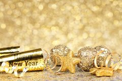 New Years Eve golden party background. New Years Eve border of confetti and golden decorations on a twinkling gold background royalty free stock photos