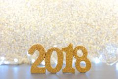 New Years Eve 2018 numbers with lights and glittery background. Shiny 2018 numbers with lights and glittery background, New Years Eve concept Stock Image