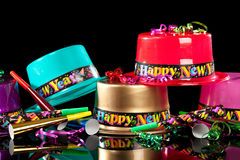 New Years' Eve party hats on black background. Colorful New Years' Eve party hats on a black background stock photos