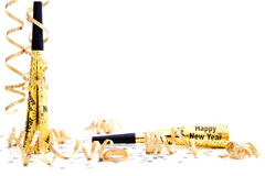 New Years Eve party noisemaker border. With confetti and streamers over a white background royalty free stock images