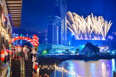New Years Eve in Pattaya. People celebrating during a New Years Eve party on the 31/12/2014 in Pattaya, Thailand with a fireworks display over the skyline in he Stock Photo