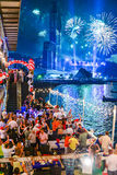 New Years Eve 2014 in Pattaya. People celebrating during a New Years Eve party on the 31/12/2014 in Pattaya, Thailand with fireworks exploding in the background Royalty Free Stock Image
