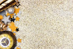 New Years Eve side border against glittery gold background Stock Photography