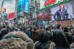 2015 New Years Eve Times Square. Crowds gather waiting for 2016 starting as early as 1pm for to bring in the New Year in New York City, famed Times Square stock photography