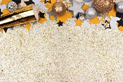 New Years Eve top border against glittery gold background Royalty Free Stock Photos