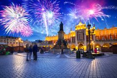 New Years firework display over the Main Square in Krakow. Poland royalty free stock photography