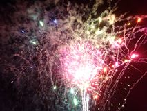 New Years Fireworks burst in the air. At Outdoor New Years Party December 31, 2014 in Honolulu, Hawaii Royalty Free Stock Photography