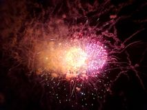 New Years Fireworks burst in the air. At Outdoor New Years Party December 31, 2014 in Honolulu, Hawaii Stock Photos