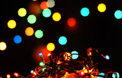 New Years garland colorful lights in snow Stock Photo