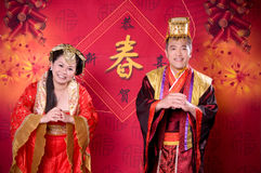New Years greeting in Chinese outfits Stock Photography
