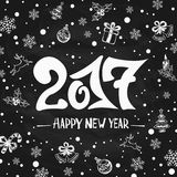 New Years greetings with holiday decorations on black chalkboard. Lettering Happy New Year 2017 written in white chalk on a black chalkboard, holiday greetings Stock Images