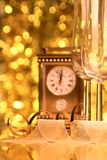 New Years. Image of New Years clock with a glasses of white wine Royalty Free Stock Photography