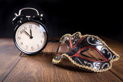 New years mask and clock Royalty Free Stock Image
