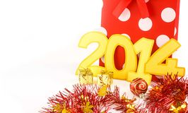 New years 2014 number  and shopping bag. On white Royalty Free Stock Images