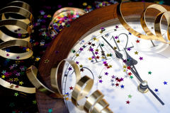 2012 New Years Party Background. Clock and festive tinsels Stock Images