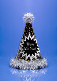 New Years Party Hat. New Years Eve party hat on a blue background royalty free stock photos