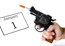 New Years Resolution quit smoking concept. With cigarette and gun Royalty Free Stock Images
