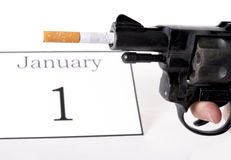 New Years Resolution quit smoking concept. With cigarette and gun Stock Image