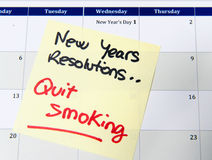 New Years Resolution quit smoking. Post it note on calendar Stock Photos
