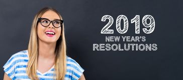 2019 New Years Resolutions with happy young woman stock image
