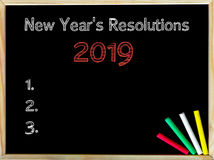 New Years Resolutions 2019. Vintage chalk text on blackboard, colored chalk in the corner, Business Vision conceptual image Royalty Free Stock Image