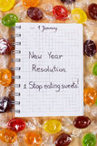New years resolutions written in notebook and colorful candies Royalty Free Stock Photography