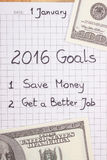 New years resolutions written in notebook and currencies dollar Stock Photos