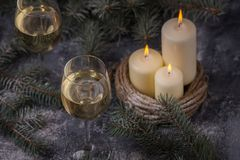 New Years theme with candles and christmas tree. Green Stock Image