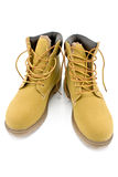 New yellow boots. On white Royalty Free Stock Photos