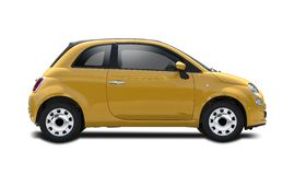 New yellow Fiat 500. Side view isolated on white Royalty Free Stock Photos