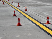 New yellow guiding line on concrete Stock Images