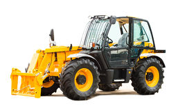 New yellow tractor royalty free stock image