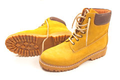 New yellow winter boots isolated. Yellow winter boots isolated on white Royalty Free Stock Images