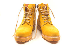 New yellow winter boots isolated. On white Royalty Free Stock Photography