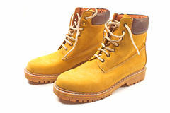 New yellow winter boots isolated. On white Stock Image