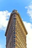 Facciata dell'edificio di Flatiron con la statua del ferro dell'uomo sul Fotografia Stock