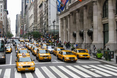 New York 5th Avenue. A large group of yellow cabs stopped at a sign in the 5th avenue, New York City, USA Stock Photography