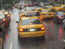 New York 5th Avenue. Rainy weather. A large group of yellow cabs on the 5th avenue, New York City, USA. Rainy weather stock photo