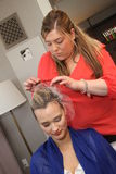 NEW YORK - APRIL 21: Creating hairstyle backstage for Anne Barge bridal show Royalty Free Stock Images