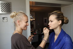NEW YORK - APRIL 21: Make up artist applying make up to the model backstage for Anne Barge bridal show Royalty Free Stock Image