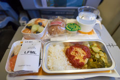Lufthansa Boeing 747-400. NEW YORK - APRIL 06, 2016: meal in Economy Class of a  Lufthansa Boeing 747.  Lufthansa is a German airline and, when combined with its Stock Images