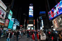 New York - April 10th 2017: People walking in Times Square at night. Editorial image of people walking in Times Square, New York at night royalty free stock image