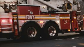 NEW YORK AUG 18 2017 - Fire truck moving fast through a busy intersection with traffic control officers in New York City