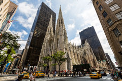 NEW YORK - AUGUST 23, 2015. ​NEW YORK - AUGUST 23: View to the St. Patricks Cathedral in Midtown Manhattan with the famous 5th Avenue on August 23, 2015. Its a Stock Images