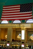 NEW YORK - AUGUST 26, 2018: American Flag hanging in the main hall at Grand Central Terminal. This historic train terminal is a stock image