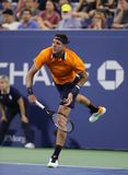 Grand Slam champion Juan Martin Del Potro of Argentina in action during his 2018 US Open first round match. NEW YORK - AUGUST 27, 2018: Grand Slam champion Juan royalty free stock photos
