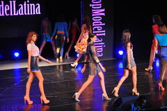 NEW YORK - AUGUST 08: Models compete on stage at Top Model Latina 2014 Royalty Free Stock Photos