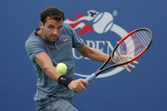Professional tennis player Grigor Dimitrov of Bulgaria in action during his US Open 2017 second round match. NEW YORK - AUGUST 31, 2017: Professional tennis Royalty Free Stock Images