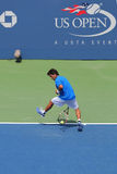 NEW YORK - AUGUST 26: Professional tennis player Massimo Gonzales using Tweener during second round match at US Open 2014 Stock Photo