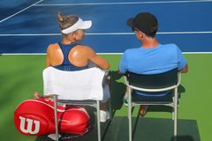 Professional tennis player Simona Halep of Romania with her coach Darren Cahill in practice for US Open 2017. NEW YORK - AUGUST 23, 2017: Professional tennis Royalty Free Stock Images